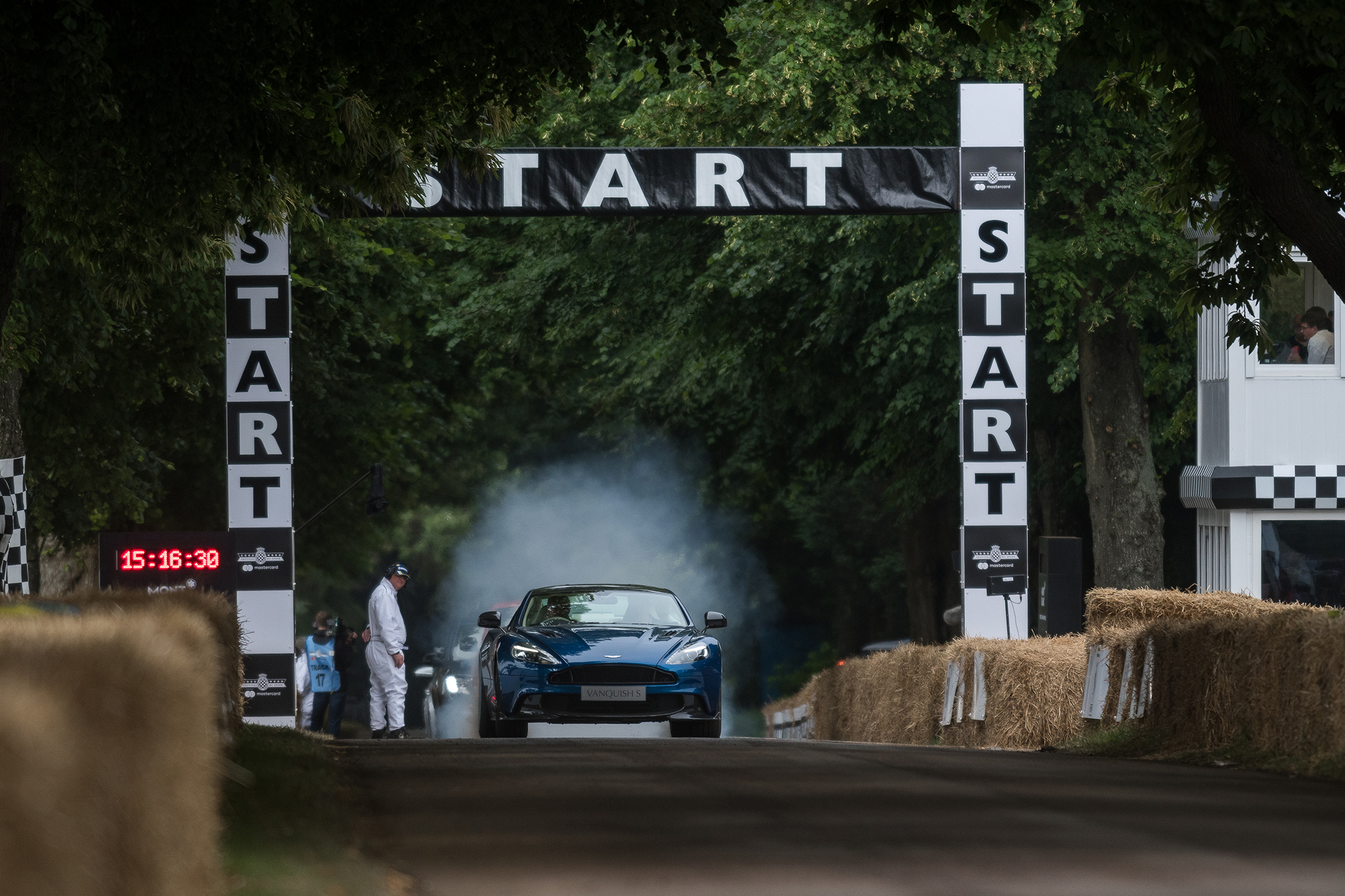 Blue Aston Martin on start line at evening race, Goodwood Festival of Speed 2017