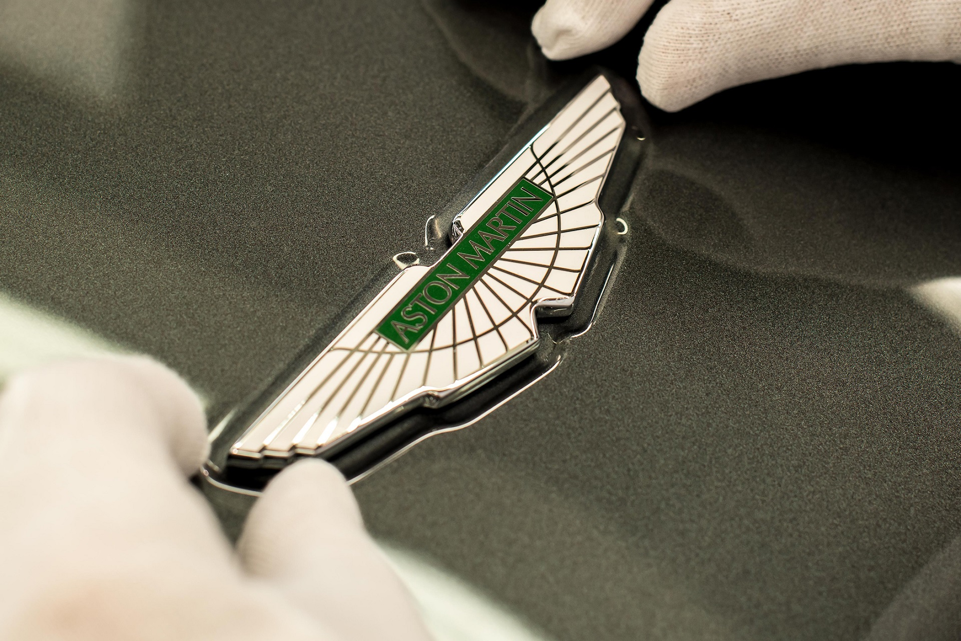 Aston Martin Wings badge being placed on to vehicle