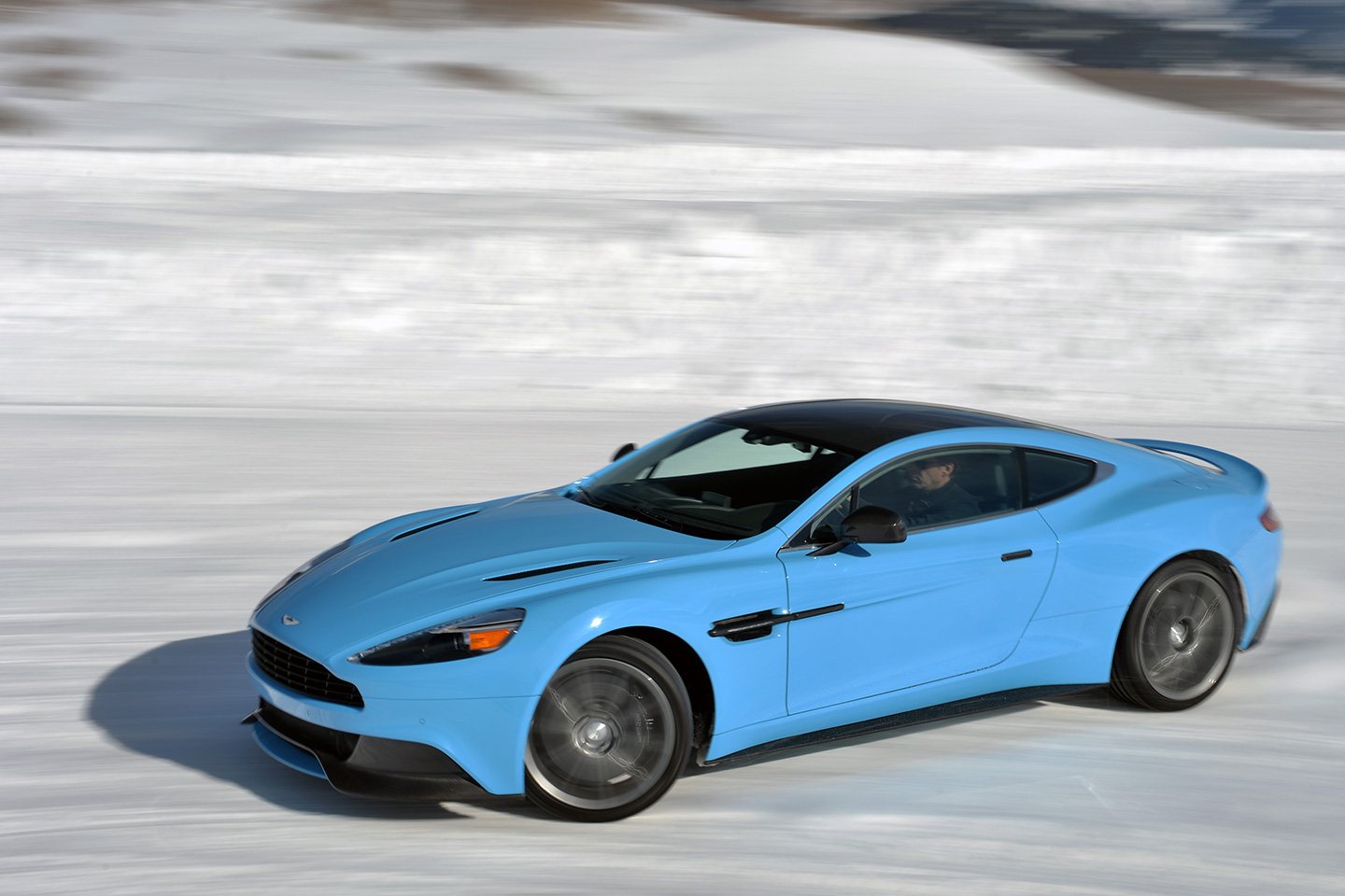 Blue Aston Martin in action during New Zealand on Ice event